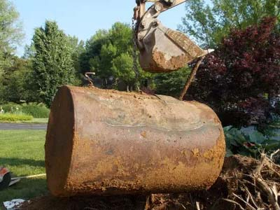 excavated rusted ungerground oil tank, GreenTRAX, Inc., Maryland heating oil storage tank installation and removal