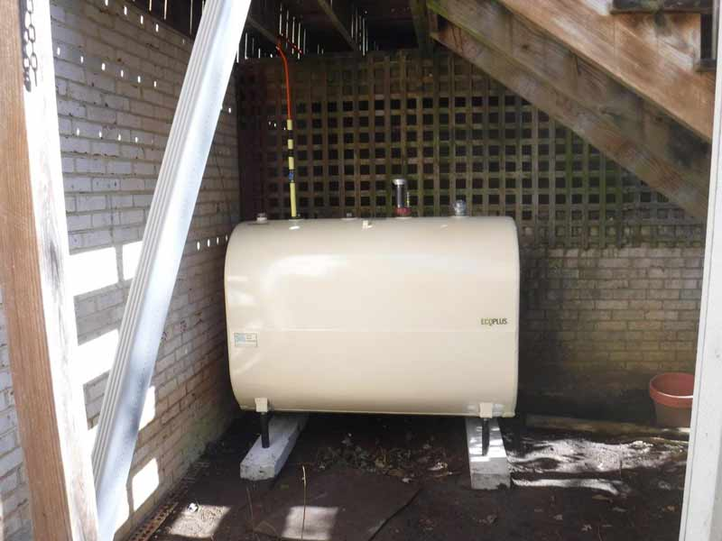 above ground Granby oil tank under stairs